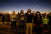21 DECEMBER 2020 - DES MOINES, IOWA: People with electric candles at a memorial vigil for the homeless people who have died in Iowa in 2020. More than 100 people gathered on the steps of the State Capitol in Des Moines to honor the homeless who died in Iowa in 2020. The ceremony is held every year on December 21, the longest night of the year. Twenty-five homeless people have died in Iowa so far in 2020.     PHOTO BY JACK KURTZ