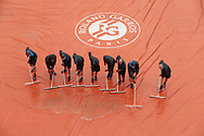 Clay gardeners of Suzanne Lenglen stadium are removed the water of the tarpaulin during the Roland Garros 2020, Grand Slam tennis tournament, on October 5, 2020 at Roland Garros stadium in Paris, France - Photo Stephane Allaman / ProSportsImages / DPPI