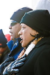 Couple watching inauguration of Barack Obama from front steps of Lincoln Memorial, Washington D.C., USA.
