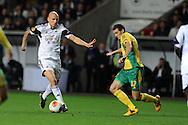 Swansea city's Jonjo Shelvey goes past Artem Fidler.  ®.UEFA Europa league match, Swansea city v FC Kuban Krasnodar at the Liberty Stadium in Swansea, South Wales on Thursday 24th October 2013. pic by Andrew Orchard, Andrew Orchard sports photography,