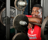 Powerlifter Jermaine Edie poses for a portrait at Gold's Gym in the Town of Wallkill on Wednesday, Aug. 10, 2011.