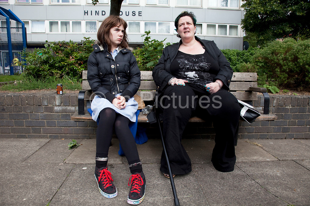 Mother Louise Irwin-Ryan with her daughter Georgia (11). Hanging around in the Harvist Estate, Arsenal, North London. Louise is on various benefits to help support her family income, and housing, although recent government changes to benefits may affect her family drastically, possibly meaning they may have to move out of London. Louise Ryan was born on the Wirral peninsula in 1970.  She moved to London with her family in 1980.  Having lived in both Manchester and Ireland, she now lives permanently in North London with her husband and two children. Through the years Louise has battled to recover from a serious motorcycle accident in 1992 and has recently been diagnosed with Bipolar Affective Disorder. (Photo by Mike Kemp/For The Washington Post)