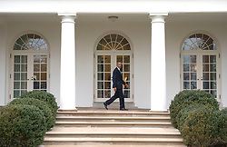 President Barack Obama walks on the colonnade after leaving the Oval Office for the last time as President, in Washington, D.C. on January 20, 2017. Later today President-Elect Donald Trump will be sworn-in as the 45th President. Photo by Kevin Dietsch/UPI