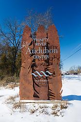 Entrance sign in snow, Trinity River Audubon Center, Dallas, Texas, USA.