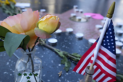 October 2, 2017 - Los Angeles, California, U.S - Flowers and candles are placed at the Hollywood Walk of Fame star of Tom Petty in Los Angeles, on Monday, Oct. 2, 2017. Tom Petty, the unpretentious, hard-working Los Angeles-based singer-songwriter whose band the Heartbreakers remained true to its classic-rock roots though decades of fleeting musical fads and styles, was near death today following an apparent heart attack. (Credit Image: © Ringo Chiu via ZUMA Wire)