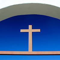 USA, California, Oceanside. Cross over gate at Old Mission San Luis Rey de Francia.