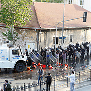 Besiktas's supporters clash with Turkish riot police during their before Turkish superleague soccer match Besiktas between Genclerbirligi at BJK Inonu Stadium in Istanbul Turkey on Saturday 11 May 2013. Police used water cannons and tear gas against the Besiktas supporters near inonu stadium. Photo by Aykut AKICI/TURKPIX