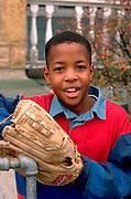 Youth age 11 playing baseball at home.  St Paul  Minnesota USA