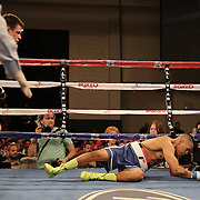 KISSIMMEE, FL - MARCH 06:  Fernando Martinez (R) falls to the canvas after a punch by Anthony Way during the Telemundo Boxeo boxing match at the Kissimmee Civic Center on March 6, 2015 in Kissimmee, Florida. (Photo by Alex Menendez/Getty Images) *** Local Caption *** Fernando Martinez; Anthony Way