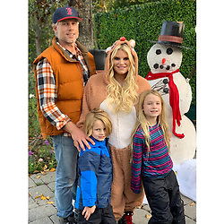 """Jessica Simpson releases a photo on Twitter with the following caption: """"""""❄️Snow Day at the Johnson's❄️ Creating traditions and making memories!! I love the holidays!!!"""""""". Photo Credit: Twitter *** No USA Distribution *** For Editorial Use Only *** Not to be Published in Books or Photo Books ***  Please note: Fees charged by the agency are for the agency's services only, and do not, nor are they intended to, convey to the user any ownership of Copyright or License in the material. The agency does not claim any ownership including but not limited to Copyright or License in the attached material. By publishing this material you expressly agree to indemnify and to hold the agency and its directors, shareholders and employees harmless from any loss, claims, damages, demands, expenses (including legal fees), or any causes of action or allegation against the agency arising out of or connected in any way with publication of the material."""