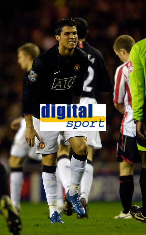 Photo: Jed Wee/Sportsbeat Images.<br /> Sunderland v Manchester United. The FA Barclays Premiership. 26/12/2007.<br /> <br /> Manchester United's Cristiano Ronaldo feels pain in his left ankle shortly before being taken off in the second half.