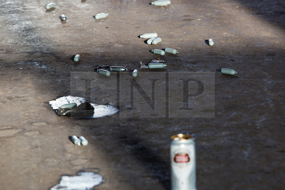 © Licensed to London News Pictures. 22/12/2013. London, UK. Empty laughing gas canisters on the area outside Unit 10, Studio Spaces in Pennington Street, East London. Around 16 emergency vehicles attended an incident in the early hours of 22 December 2013 where a 'Santa Stamp' rave event was being held and two people were stabbed, windows were broken and objects were thrown from windows on the top floor. Photo credit : Vickie Flores/LNP