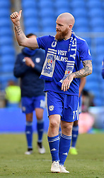 Cardiff City's Aron Gunnarsson walks around the pitch after his final home game for his club after the Premier League match at Cardiff City Stadium.