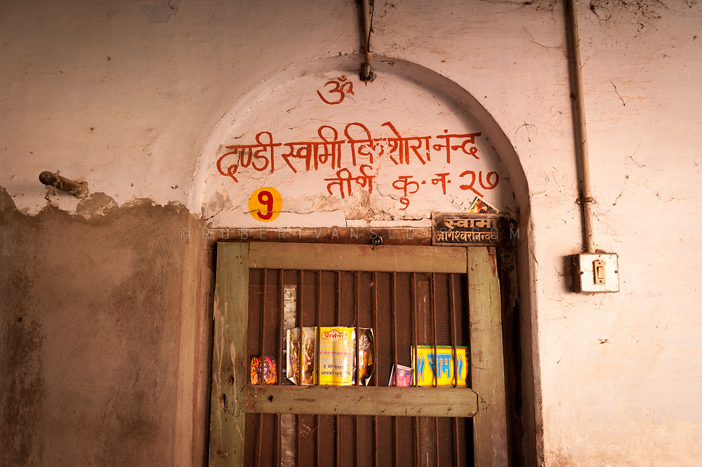 Door to the room of a sannyasin at the Mumukshu Bhawan hospice in Varanasi, India. Photo © robertvansluis.com