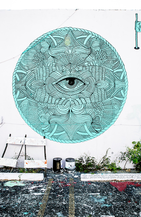 An unblinking central eye in a mural painted on a parking lot wall in Miami's Wynwood district, famed for its street art.