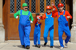 © Licensed to London News Pictures. 08/04/2017. London, UK. A family dressed as characters from Super Mario join participants taking part in the inaugural Games Character Parade, walking from Guildhall to Paternoster Square..  The event formed part of the London Games Festival welcoming cosplayers, wearing costumes inspired by videogame characters, to the UK's biggest parade of cosplayers.   Photo credit : Stephen Chung/LNP