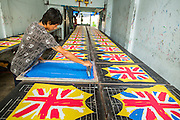 "30 SEPTEMBER 2012 - BANGKOK, THAILAND: Workers screen the ""Union Jack"" on clothing in a shop in the Raminthra section of Bangkok, Thailand.    PHOTO BY JACK KURTZ"