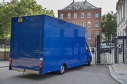 © Licensed to London News Pictures. 12/07/2016. London, UK. A removals van drives in the back entrance of Downing Street. Theresa May will become Prime Minister tomorrow after the last candidate for leadership of the Conservative party stood down. Photo credit: Peter Macdiarmid/LNP