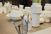 A bouquet of wrenches accent a display of machine-inspired porcelain dining wear in the booth of Diesel Living with Seletti, a collaboration of Diesel and the Italian design firm.