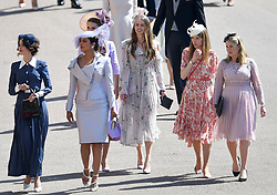 Suits actress Abigail Leigh Spencer (left) and Bollywood actress Priyanka Chopra (second left) arrive at St George's Chapel in Windsor Castle for the wedding of Prince Harry and Meghan Markle.