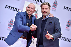John Travolta attends the Hand And Footprint Ceremony Honoring Pitbull at TCL Chinese Theatre on December 14, 2018 in Hollywood, CA, USA. Photo by Lionel Hahn/ABACAPRESS.COM