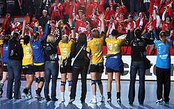 Team of Krim and Krimovci, fans of Krim with players at the end at handball match at Main round of Champions League between RK Krim Mercator, Ljubljana and CS Oltchim Rm. Valcea, Romania, in Arena Kodeljevo, Ljubljana, Slovenia, on 28th of February 2009. Krim won 35:34.