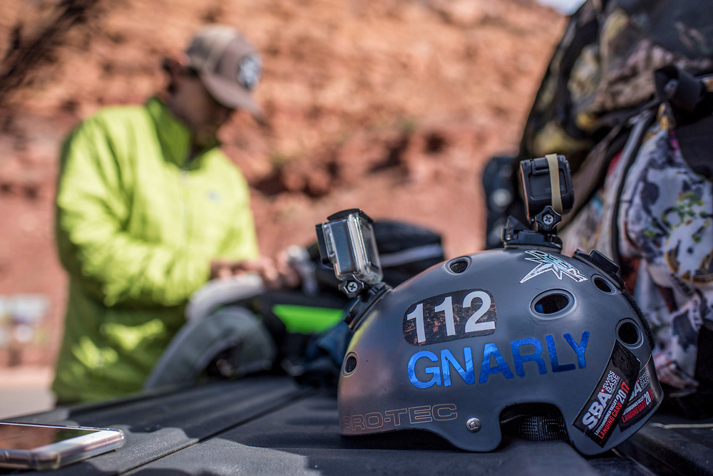 Alec Gragg checks his parachute before a BASE jump in Moab, Utah.