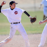 Shiprock Chieftain Pedro Tom (3) throws past Hot Springs Tiger Logan Cummins (18) as he tries for a double play into second base Saturday at Thoreau High School.