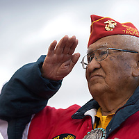 Navajo Code Talker Thomas Begay salutes during the singing of the national anthem as part of Begay being honored during the halftime show of the Shiprock and Chinle football game at Shiprock High School Saturday.