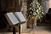 An open Christian Bible in the interior of St. Marys church on Holy Island, on 27th September 2017, on Lindisfarne Island, Northumberland, England. The Holy Island of Lindisfarne, also known simply as Holy Island, is an island off the northeast coast of England. Holy Island has a recorded history from the 6th century AD; it was an important centre of Celtic and Anglo-saxon Christianity. After the Viking invasions and the Norman conquest of England, a priory was reestablished.