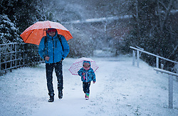 © Licensed to London News Pictures. 10/12/2017. Reading, UK. A man and his daughter walk in the fresh snow near Reading, Berkshire, as parts of the south east of England are blanketed with snow for the first time this winter. Photo credit: Peter Macdiarmid/LNP