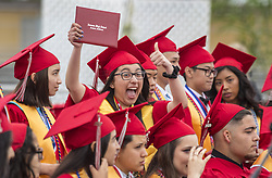 May 23, 2019 - Anaheim, California, U.S. - A happy graduate holds her diploma and gives a thumbs-up during the commencement ceremony for the Savanna High School Class of 2019 at Handel Stadium at Western High School. (Credit Image: © Mark Rightmire/SCNG via ZUMA Wire)