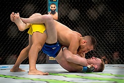 Danny Henry (Blue shorts) in action against Daniel Teymur in their lightweight bout during the UFC Fight Night at the SSE Hyrdo, Glasgow. PRESS ASSOCIATION Photo. Picture date: Sunday July 16, 2017. See PA story SPORT UFC. Photo credit should read: Craig Watson/PA Wire