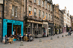 Edinburgh, Scotland, UK. 17 October 2020. Saturday afternoon in Edinburgh city centre during 16 day short circuit lockdown and bars are closed but cafes remain open. Streets in the Old town are very quiet and reminiscent of the eerie emptiness seen during the full lockdown earlier this year.In the Grassmarket Cafe Jacques is open but next door the Black Bull pub is closed. Iain Masterton/Alamy Live News