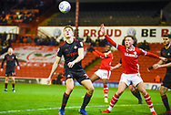 Jimmy Dunne of Sunderland (30) eyes on the ball as Cauley Woodrow of Barnsley (9) appeals during the EFL Sky Bet League 1 match between Barnsley and Sunderland at Oakwell, Barnsley, England on 12 March 2019.
