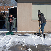 Hayden Vidal and his mom Ruth shovel their driveway  Wednesday afternoon in Gallup.