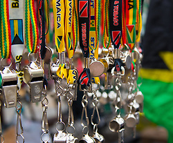 London, August 30th 2015. Whistles for sale, a regular feature adding to the riot of sound and colour as revellers await the start of the Notting Hill Carnival.