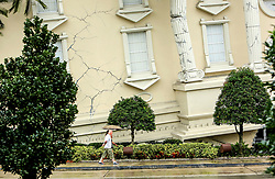 Tourists walk past the WonderWorks attraction on a nearly deserted International Drive in Orlando, FL, USA. on Sunday, September 10, 2017 as wind and rain from Hurricane Irma arrives in Central Florida. Photo by Jacob Langston/Orlando Sentinel/TNS/ABACAPRESS.COM
