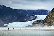 Tourists visit Mendenhall Glacier Falls near Juneau, Alaska.