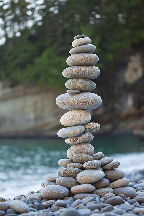 A tall stone cairn on the beach at Cullite Cove, West Coast Trail, British Columbia, Canada.