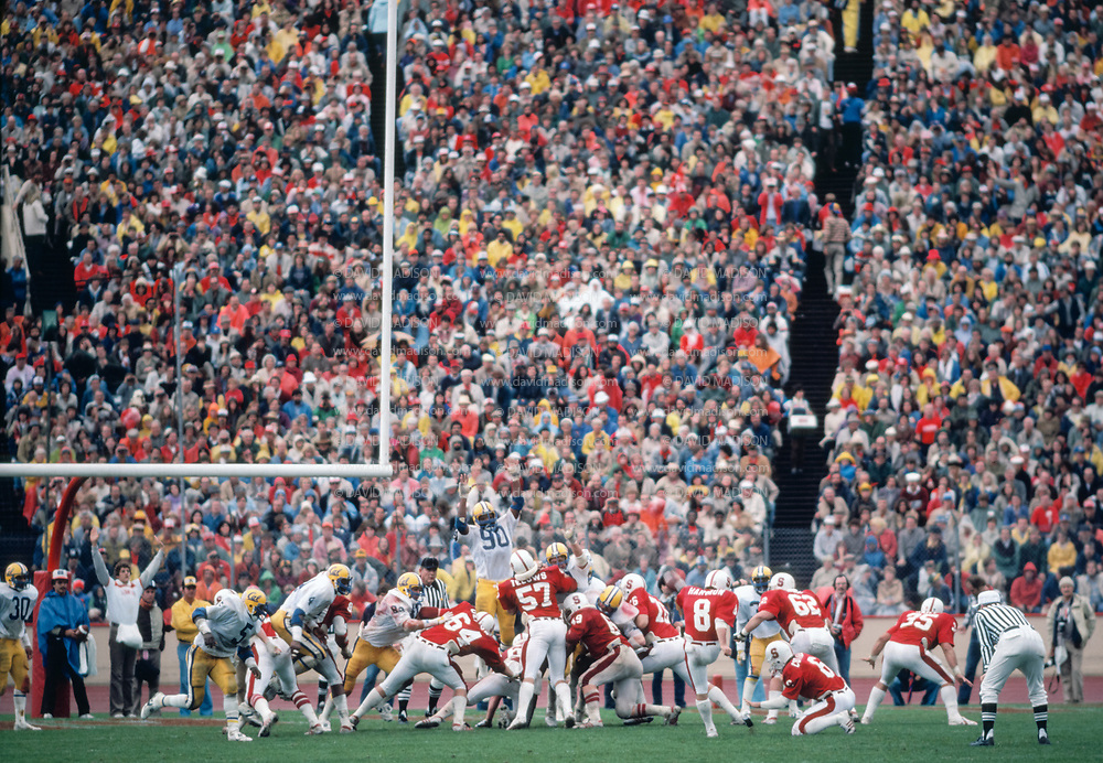 COLLEGE FOOTBALL:  Stanford vs Cal on November 21, 1981 at Stanford Stadium in Palo Alto, California.  Visible players include Mike Teeuws #57, Mark Harmon #8, Steve Cottrell #6 of Stanford; Reggie Camp #90 of Cal.  Photograph by David Madison.  www.davidmadison.com.
