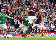 The William Hill Scottish FA Cup Final 2012 Hibernian Football Club v Heart Of Midlothian Football Club..19-05-12...Hibernian's Paul Hanlon put's his head in where it hurts to deny Hearts Andy Webster a certain goal        during the William Hill Scottish FA Cup Final 2012 between (SPL) Scottish Premier League clubs Hibernian FC and Heart Of Midlothian FC. It's the first all Edinburgh Final since 1986 which Hearts won 3-1. Hearts bid to win the trophy since their last victory in 2006, and Hibs aim to win the Scottish Cup for the first time since 1902....At The Scottish National Stadium, Hampden Park, Glasgow...Picture Mark Davison/ ProLens PhotoAgency/ PLPA.Saturday 19th May 2012.