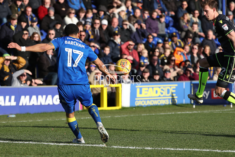 AFC Wimbledon striker Andy Barcham (17) running down the wing and crossing the ball during the EFL Sky Bet League 1 match between AFC Wimbledon and Bristol Rovers at the Cherry Red Records Stadium, Kingston, England on 17 February 2018. Picture by Matthew Redman.