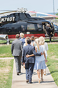 Donald Trump, Jr., and wife Vanessa Trump walk together alongside his brothers and sisters to welcome their father and GOP Presidential nominee Donald Trump during his arrival by helicopter to the Republican National Convention July 20, 2016 in Cleveland, Ohio. Trump flew into the lakeside airport by his private jet and then by helicopter for a grand arrival.