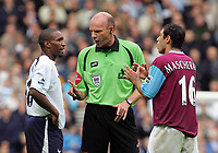Shoulder Biting incident : Referee Mr Steve Bennett (booking both players) tries to restore order  as the arguement carries on.  Javier Mascherano (West Ham) right. Jermaine Defoe (left). BARCLAYS PREMIERSHIP. TOTTENHAM HOTSPUR v WEST HAM UNITED. 22/10/2006. CREDIT COLORSPORT / KIERAN GALVIN