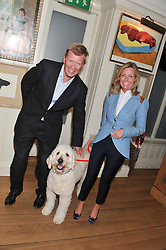 CHRISTOPHER & KATIE PLUMMER and their dog Dougle at the launch of George's Dinner for Dogs menu in aid of The Dog's Trust held at George, 87-88 Mount Street, London on 19th March 2013.