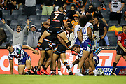 The Tigers celebrate the Michael Chee-Kam try. Wests Tigers v Vodafone Warriors, NRL Rugby League. Campbelltown Stadium, Sydney, Australia. Sunday 24th March 2019. Copyright Photo: David Neilson / www.photosport.nz