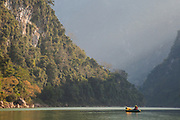 Robert Hahn contemplates the karst cliffs rising above him on the Nam Ou River near Muang Ngoi, Laos.