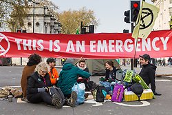 A group of activists hold an impromptu art class on Oxford Street as hundreds of environmental protesters from Extinction Rebellion occupy Marble Arch, camping in the square and even on the streets, blocking access to traffic on Park Lane and Oxford Street in London's usually traffic-heavy west end. . London, April 16 2019.