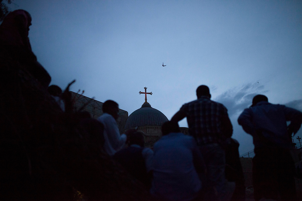 Apr 19, 2014 - Jerusalem, Israel - A bird is flying over the Ethiopian section of the Church of The Holy Sepulcher, as Ethiopian Orthodox Christians are  taking part in the ceremony of the Holy Fire . The event is part of the Great Saturday, the day preceding Orthodox Easter.